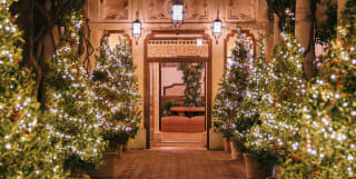 Belmond Grand Hotel Timeo entrance with Christmas trees