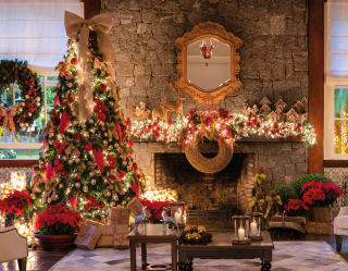 festive scene with a twinkling christmas tree and decorated fireplace