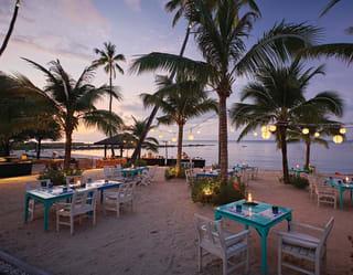 Beachside dining at Belmond Napasai
