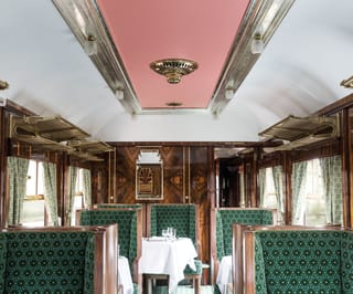 Pink and silver ceiling of vintage train carriage designed by Wes Anderson