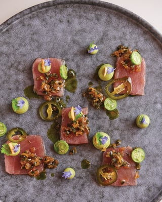 Close up of tuna decorated with edible flowers