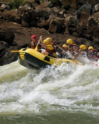 A group of guests white water rafting down the Urubamba River