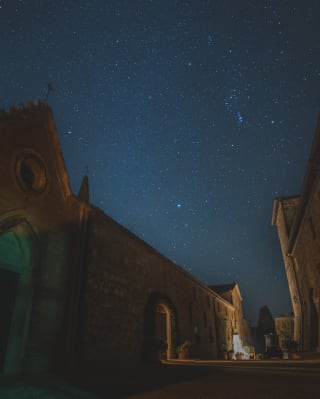 starry skies above tuscany