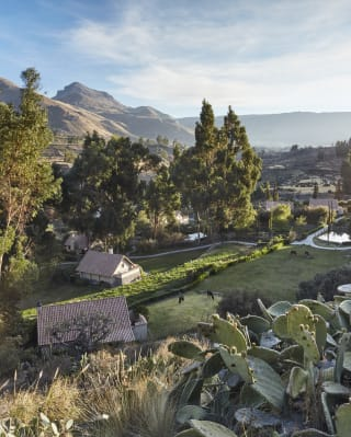 Spanish-style casita bungalows in a lush Peruvian valley