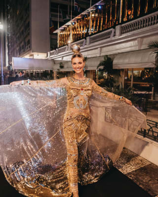 Lady in a gold shimmering carnival dress