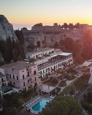 Aerial view of Grand Hotel Timeo at sunset