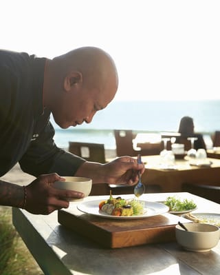 Balinese chef preparing dishes in an outside kitchen