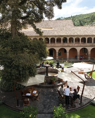 Aerial view of Monasterio and garden courtyards in Cusco