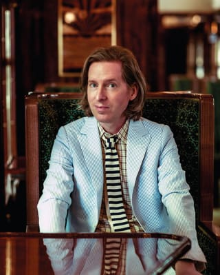 Portrait of Wes Anderson sitting in the Cygnus carriage