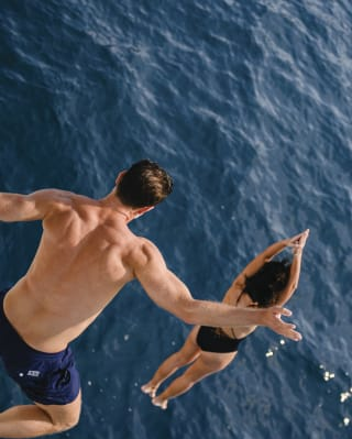 Aerial view of a couple leaping into the Atlantic Ocean