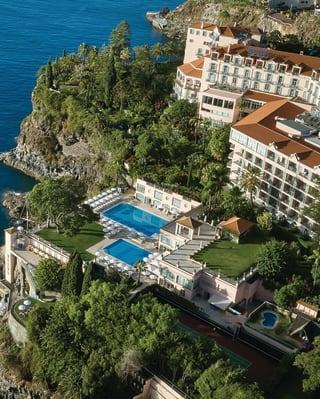 Aerial view of Reid's Palace under blue skies