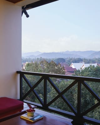 View from a balcony across Luang Prabang at sunset