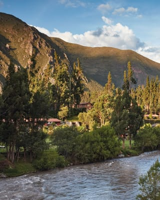 The Urubamba river curving through a tranquil Peruvian valley