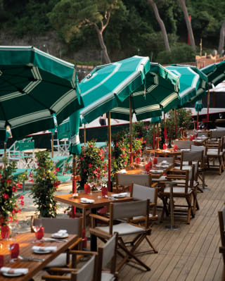 Beach restaurant tables and chares with parasols