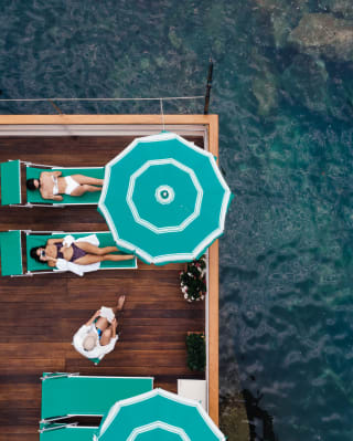 Top shot of the deck with two women lying on deck chairs