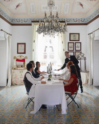 a group is having a traditional Italian lunch in a room