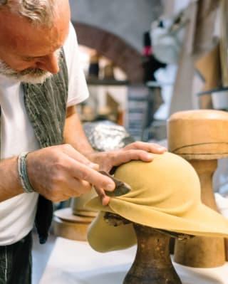 a milliner at work