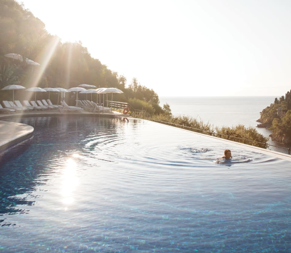 A lady in a infinity pool at Splendido hotel a Belmond hotel